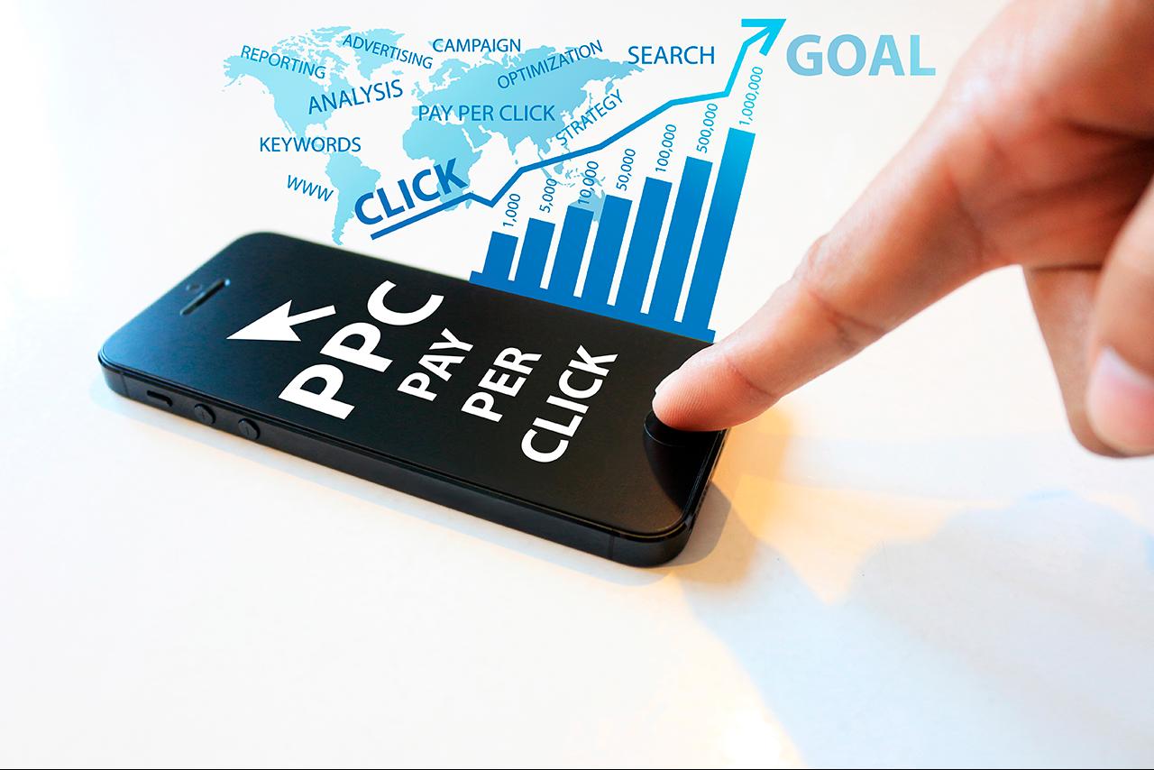 mídia paga celular ppc pay per click dedo clicando gráfico